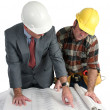 Stock Photo: Reviewing Blueprints