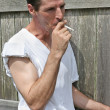 Smoking Man - Inhale - Stock Photo