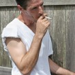 Smoking Man - Profile - Stock Photo