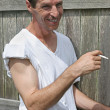 Smoking Man - Smiling - Foto Stock