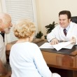 Stock Photo: Doctor Gives Good News to Patient