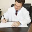 Doctor Writes in Chart — Stock Photo