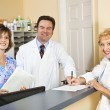 Doctor and Staff Greet Patient — Stock Photo #6801476