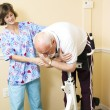 Physical Therapist Helping Patient — Stock Photo