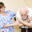 Постер, плакат: Physical Therapist Works with Senior
