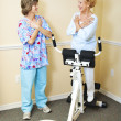 Physical Therapist with Chiropractic Patient - Stock Photo