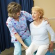 Stock Photo: Senior Lady and Physical Therapist