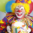 Foto Stock: Birthday Clown with Blank Cake