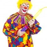 Clown Blows Up Balloon — Stock Photo