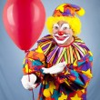 Clown Offers Balloon — Stock Photo #6802336