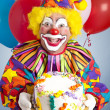 Foto Stock: Crazy Clown with Birthday Cake