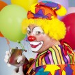 Tipsy Clown Sneaks a Drink — Stockfoto