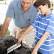 Boy Helps Dad - Stock Photo
