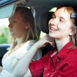 Distracted Teenage Driver - Stock Photo