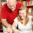 Father Helps Daughter Study — Stock Photo