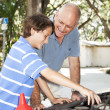 Father Teaches Son to Fix Car — Stock Photo #6802679