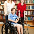Kids in Library - Disabilities - Stockfoto