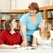 Librarian and Teen Students — Stock Photo