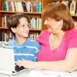 Mom and Son in Library — Stock Photo