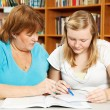 Mother Helps Teen with Homework — Stok fotoğraf