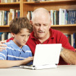 Student and Teacher on Computer — Stock Photo