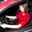 Teenage Girl Texting and Driving - Stock Photo