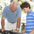 Working on Car Engine Together — Stock Photo