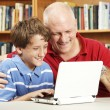 Father and Son Use Netbook Computer — Stock Photo