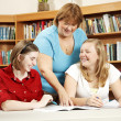 Friendly Teacher Helping Students — Stock Photo