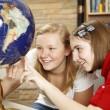 Library Teens Looking at Globe — Stock Photo