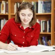 Teenage Girl in Library — Stock Photo