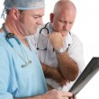 Concerned Doctors with Xrays — Stock Photo