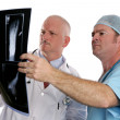 Doctors Examining Xrays - Stock Photo