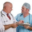 Medical Resident Instructs Intern — Stock Photo