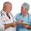 Stock Photo: Medical Resident Instructs Intern