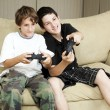 Brothers Play Video Games — Stok fotoğraf