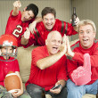 Stock Photo: Football Fans Watch Superbowl