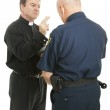 Priest Blesses Policeman — Stock Photo #6804738