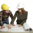 Going Over Blueprints Together — Stock Photo
