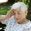Sad Senior with Headache - Stock Photo