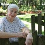 Senior Lady In Garden — Stock Photo