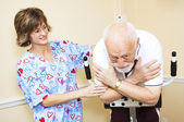 Physical Therapist Works with Senior — Stock Photo