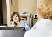 Receptionist Greets Patient — Stock Photo