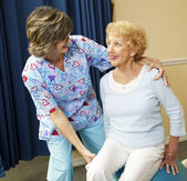Senior Lady and Physical Therapist — Stock Photo