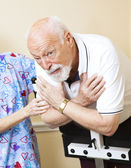 Worried Senior Doing Physical Therapy — Stock Photo