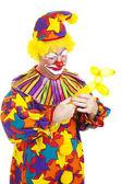 Clown Twists Balloon Into Dog — Stock Photo
