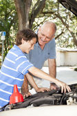 Father Teaches Son to Fix Car — Stock Photo