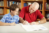 Dad Helps Son with Homework — Stock Photo