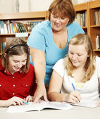 Librarian Helps Students — Stock Photo