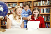 Library Kids on Netbook Computer — Stock Photo